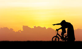 Silhouette of Mother teaching son biking Stock Photo