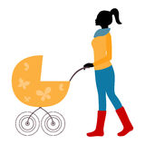Silhouette of mother walking with stroller in cold weather Royalty Free Stock Photo