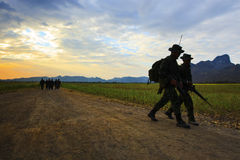 Silhouette motion of long range patrolling soldier walking on di Royalty Free Stock Photo