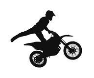 Silhouette of motocross rider Stock Images