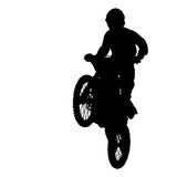 Silhouette of motocross rider jump isolated on white background Stock Images