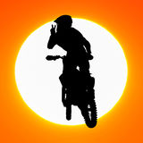 Silhouette of motocross rider jump in the sky Royalty Free Stock Images