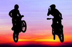 Silhouette of motocross rider jump in the sky Royalty Free Stock Photography