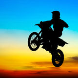 Silhouette of motocross rider jump in the sky Stock Photography