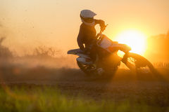 Silhouette motocross speed in track Royalty Free Stock Photos