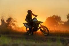 Silhouette motocross speed in track Stock Photo