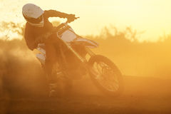 Silhouette motocross speed in track Stock Photography