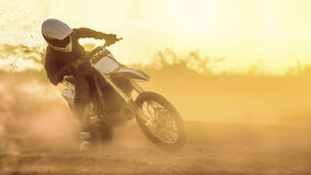 Silhouette motocross speed in track Royalty Free Stock Image