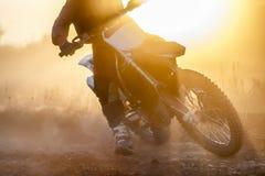 Silhouette motocross speed in track Stock Photos