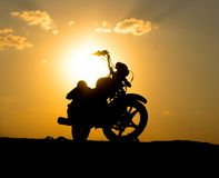Silhouette of a motorcycl on background dark sky Stock Photos