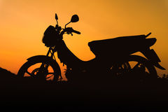 A silhouette of a motorcycle from a side view Stock Photography