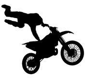 Silhouette of a motorcycle stuntman Stock Photos