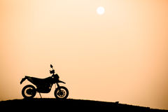 Silhouette of motorcycle Stock Images