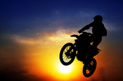 Silhouette of a motorcyclist Stock Photography