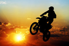Silhouette of a motorcyclist on a background of dark sky Royalty Free Stock Images