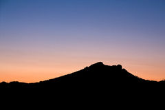 Silhouette of a Mountain Stock Images