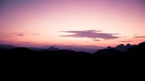 Silhouette of Mountain Area Under Purple Beige Sky during Sunset Royalty Free Stock Photos