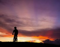 The silhouette of mountain bicycle rider Stock Photo