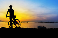 Silhouette mountain bike cyclist and great sunrise Royalty Free Stock Photography