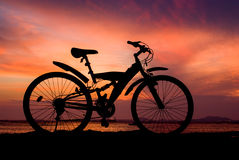 Silhouette of mountain bike parking on jetty Stock Photography