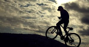 Silhouette of Mountain bike.Sport and healthy life.Extreme sports.Mountain bicycle and man.Life style outdoor extreme sport.  royalty free stock photography
