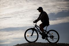 Sport and healthy life.Extreme sport. Silhouette of Mountain bike.Sport and healthy life.Extreme sports.Mountain bicycle and man.Life style outdoor extreme sport Stock Image