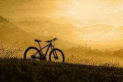 Silhouette Mountain bike at sunset Stock Images