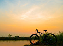 Silhouette Mountain bike  at sunset Stock Photography