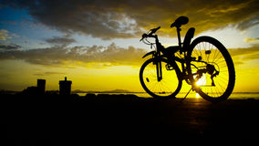Silhouette of mountain bike with sunset sky Stock Photography