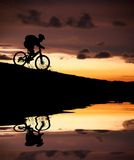 Silhouette of mountain biker with Reflection Royalty Free Stock Image