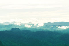 Silhouette of mountain and countryside. Used color tool and green filter for soft tone Royalty Free Stock Images