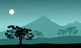 Silhouette of mountain and moon Stock Images