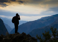 Silhouette of a mountain photographer. With a backpack Stock Photos