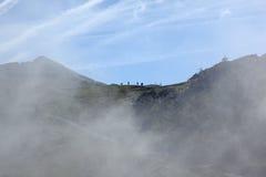Silhouette on mountain ridge Stock Images