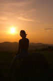 Silhouette in the mountain at sunset. Woman silhouette in the mountain at sunset royalty free stock photos