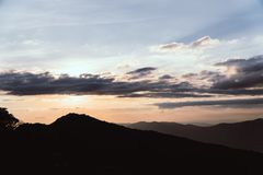 Silhouette Mountain sunset stock photography