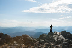 Silhouette on mountain top. Royalty Free Stock Images