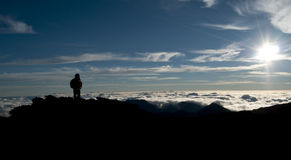 Silhouette of a Mountaineer Trekker Royalty Free Stock Photo