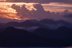 Silhouette of Mountains Above the Water under Stock Images