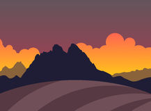 Silhouette of Mountains and field in Sunset Stock Photo