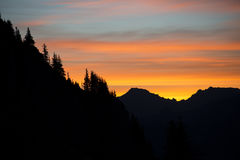 Silhouette of mountains and trees at sunrise Royalty Free Stock Photography