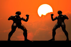 Silhouette muay thai boxer in sunset background Stock Images
