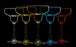 Silhouette of multicolor margarita glass on black Royalty Free Stock Image