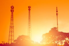 Silhouette multiple band telephone cell site towers Stock Photo