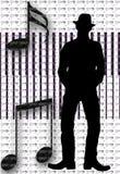 Silhouette musicale d'homme Photographie stock libre de droits