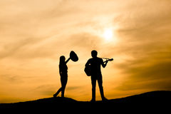 Silhouette of musician Stock Images