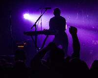 Silhouette of a musician on the stage Stock Image