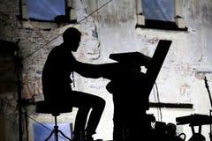 Silhouette of a musician Stock Photos
