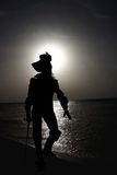 Silhouette of musketeer Stock Images