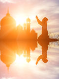 Silhouette muslim boy praying faith in allah God of islam suprem Royalty Free Stock Photo